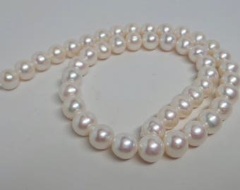Very nice lustrous creamy white off round freshwater pearls. 9 mm to 10 mm FW pearls. 16 inches strand. WP242