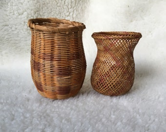 Woven Wicker Vases With Plum And Peachy Colors On Natural Wicker