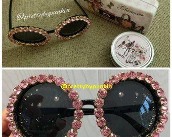Pink sunglasses. Accessories not included.