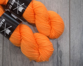 DK weight merino yarn 100% Superwash Merino Sweater weight yarn. Double Knit Weight yarn. Neon orange. Semi-Solid neon orange yarn. Tonal