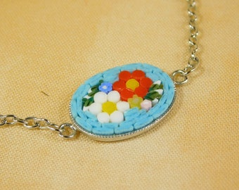 Micro mosaic bracelet - red and white flower on light blue background