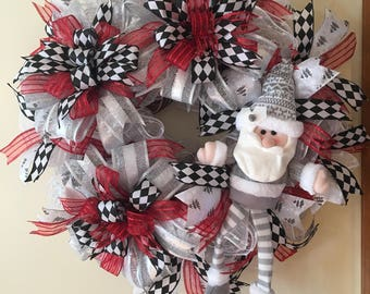 Deco Mesh red, black, and silver winter or Christmas Wreath with Santa