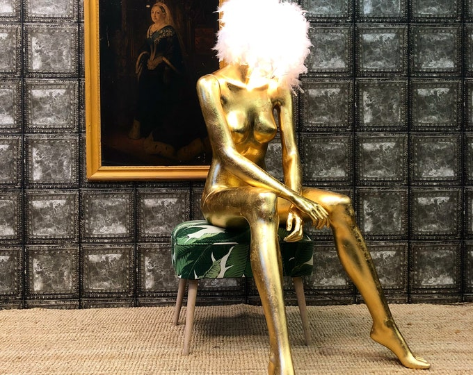 In aid of British Heart Foundation Gold leaf mannequin sitting female lamp light