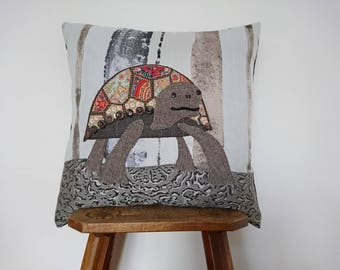 Tortoise cushion cover handmade applique using a mixture of recycled fabrics