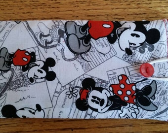 Hard to find mickey and minnie print. Mickey and Minnie comic strip eyeglass case.