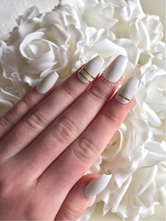 Items similar to White coffin shaped nails with simple gold design ...