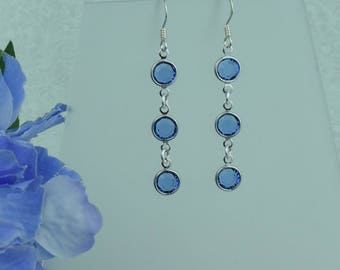 Sapphire Swarovski crystal dangle earrings.Elegant sparkling earrings for daytime or special occasions.Ideal for bridesmaid or prom.