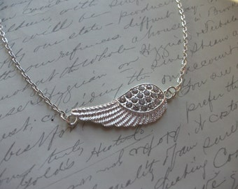 Silver wing necklace with rhinestones