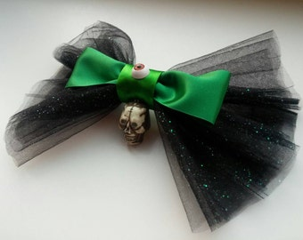 Big hairbow, made with black netting, a skull, and an eyeball!