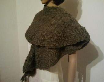Knitted wider scarf or shawl from drab wool
