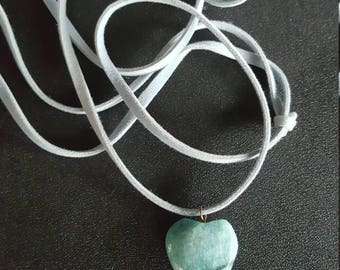 Turquoise colored heart shaped stone on a s suede cord