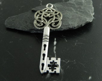 2 silver metal key charms