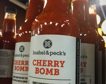 Now In Big Bottles!  10 ounce Cherry Bomb Hot Sauce Trio - Our Best Seller