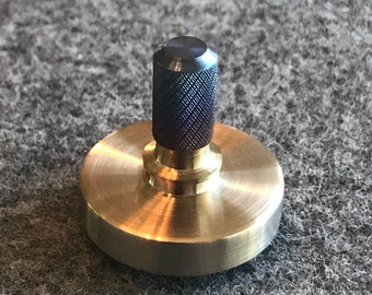 Spin Wright one inch diameter stainless steel and titanium spinning top with a tungsten carbide bearing.