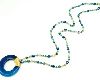 Blue agate pendant with freshwater pearl necklace.