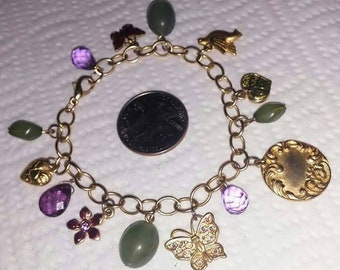 Vintage charm 7.50 inch long bracelet featuring jade beads, enamel charms, a/b rhinestone butterfly & more.