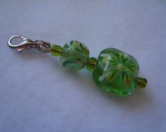Zipper pull with green glass beads