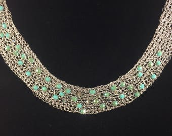 Hand crocheted collar necklace with neafs and crystals.