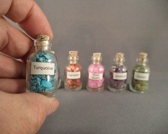 REDUCED Six Glass Bottles with Semi Precious Stone Chips was 16.50 now 13.50.