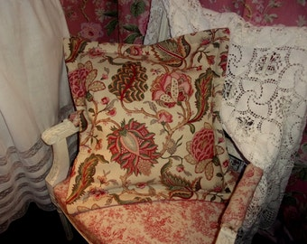 A large cushion made of old fabric; beautiful Indian flowers