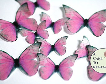 Pink edible butterflies, 12 wafer paper butterflies for wedding cake toppers. Butterflies for cake decorating and cupcake decorating.