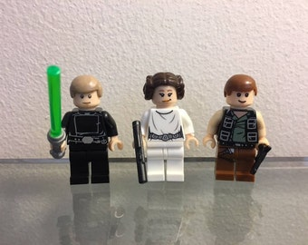 STAR WARS Set of 3 Minifigures. Perfect for Cake Toppers or Party Favors. Includes Luke, Princess Leia, Han Solo