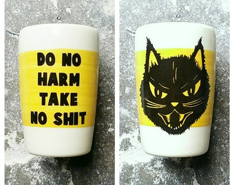 """18oz tumbler w/the phrase """"Do No Harm Take No Shit"""" & Kitty Black Cat prints, here on a wide band of yellow. Made to Order/Pick Your Color"""