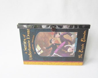 Clutch made from the original Series of Unfortunate Events book