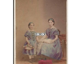 tinted cdv two girls perhaps sisters photograph one held flower basket on held book