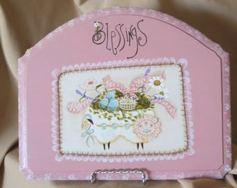 Domed plaque with sheep, eggs, basket, flowers and ribbon with the word Blessings
