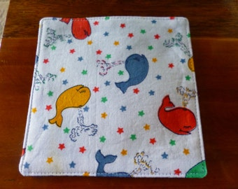 Drink coaster. Happy whales. Blue back. 12 cm x 12 cm. Cotton fabric. Fully washable.