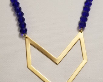 Blue Beaded Necklace with large Gold Chevron pendant
