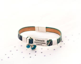 turquoise teal leather was spun glass bead bracelet