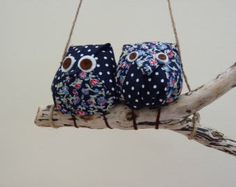 Owls on a branch, 2 blue, red and white owls