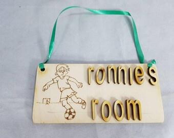 Handmade unquie  birchwood Footballer children's room door sign. Just needs a childs name.
