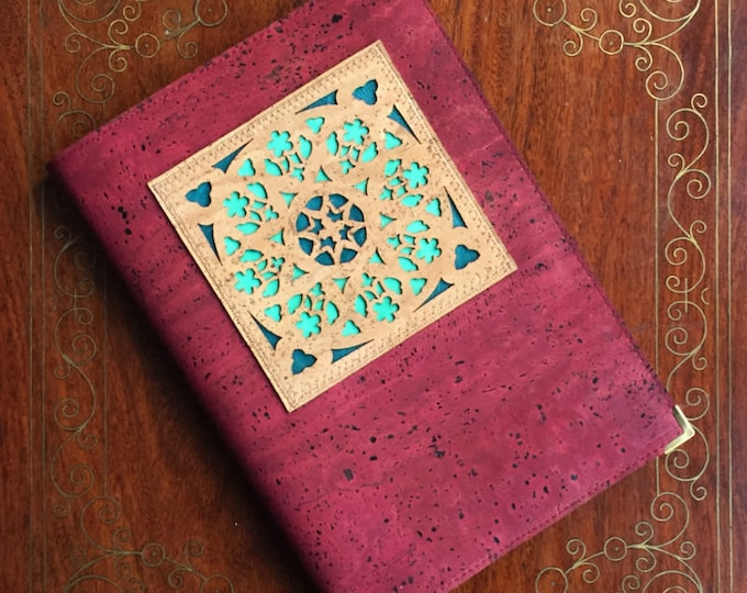 Red cork leather covered A5 notebook with geometric laser cut appliqué, inspired by a rose window, backed with coloured leathers