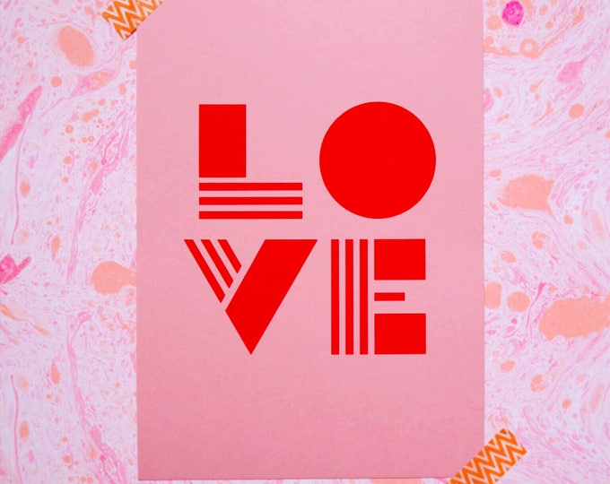 Typographic LOVE Risograph print on millennial pink paper with bold red letters