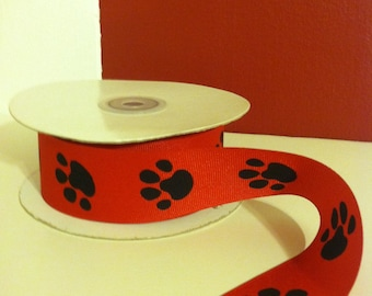 "Red and black paw print. 1.5"" grosgrain ribbon.  1, 3 or 5 yds."