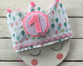Crown fabric for birthdays stamped pink and turquoise balloons