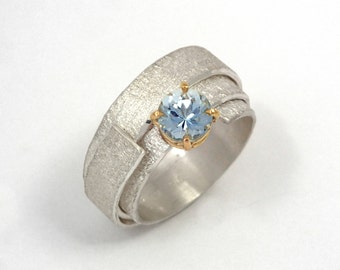 A wide band  solitaire ring made of argentium silver, with a beautiful aquamarine stone, Alternative engagement ring, Silver wrap ring.