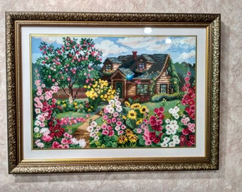 A picture embroidered with a cross. A dream house.