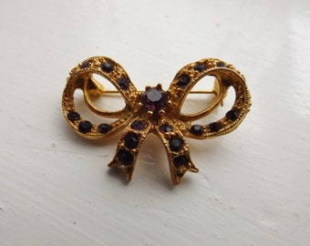 Gold Bow Brooch with Purple Diamonte Stones - SALE