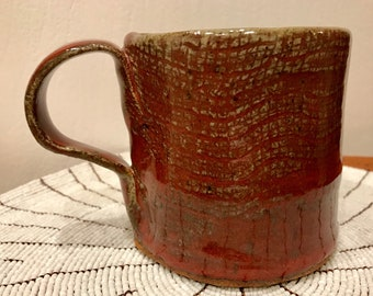 Mug, hand built burlap textured, warm red.