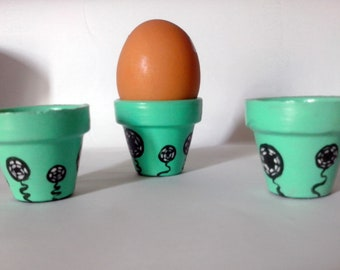 3 egg cups hand painted green