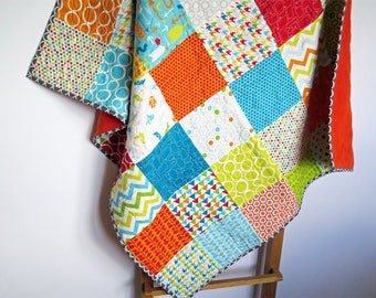 Colorful baby quilt, patchwork blanket, nursery bedding, bright colors, geometric shapes
