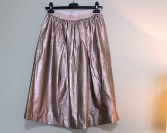 Nico skirt. Skirt 100% faux leather. Skirt with Elsatico. Wide and curled skirt. Light gold skirt. Tg. 40/42/44