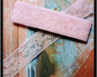 Old lace between two stained by hand