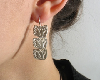 Three Sterling silver squarish print leaves attached one onto the other and dangling from silver wire. Wedding earrings, bridal earrings