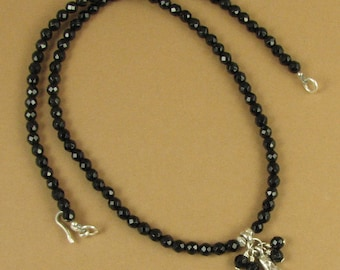 Onyx necklace. Pendant & dangles. Black faceted. Fine and sterling silver.