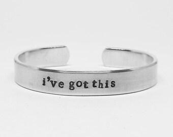 I've got this: hand stamped aluminum reminder cuff bracelet